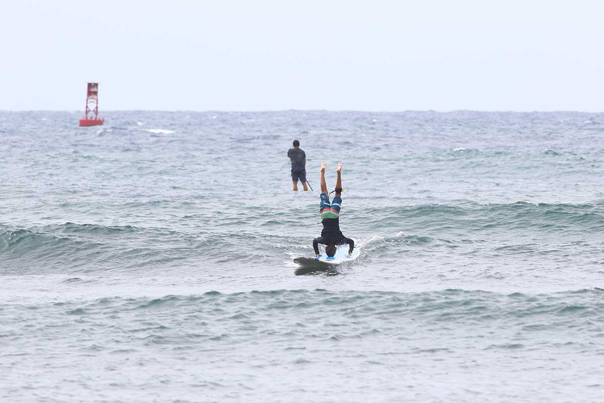 Headstands on Surf Board